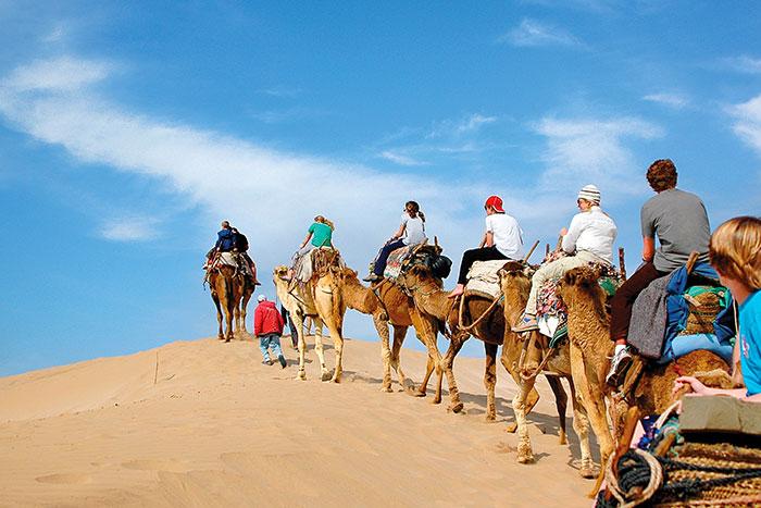 Camel Riding on Beach, Morocco