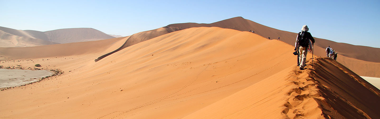 Hiking on sand dunes - Namibia & Zimbabwe Family Safari Walking Tour